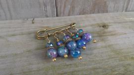 Bronskleurige dasspeld met blauw/lila glasparels