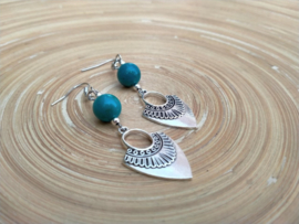 Turquoise oorbellen in Inka style