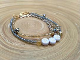 Minimalistisch letter armbandje in goud/grijs en zilver