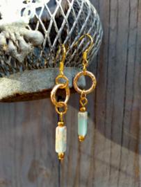 Keramieke oorbellen in turquoise en goud