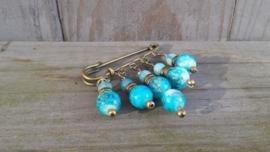 Bronskleurige dasspeld met blauw gemeleerde glaskralen