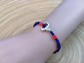 Skull armbandje in donkerblauw en oranje