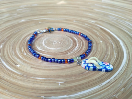 Donkerblauw en oranje enkelbandje met bijpassende choker