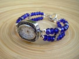 Horloge met diepblauwe glasrondellen