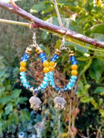 Turquoise/oranje buddha oorbellen