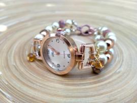 Horloge in roségoud met roomwitte glasparels en zoetwaterparels