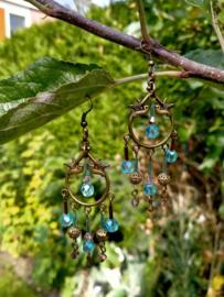 Bronskleurig/blauwe oorbellen met vogels