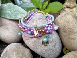 Bloemen armband in lila/turquoise/goud