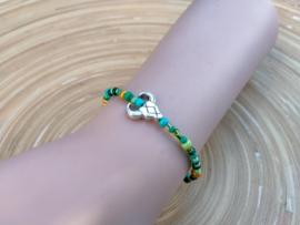 Skull armbandje in  groen en goudkleur
