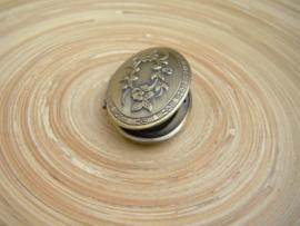 Ovaal medaillon in bronskleur