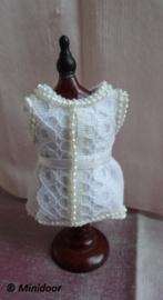Paspopje met corset