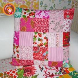 Kussenhoes patchwork rood roze wit