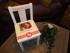 Geboortestoeltje naar aanleiding van geboortekaartje