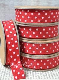 Kartonnen spoel met lint. Rood met witte stippen