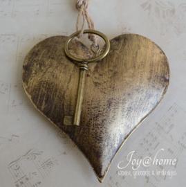 Metalen hartje oud goud met sleutel