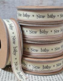 Kartonnen spoel met lint. New baby crème/bruinroze