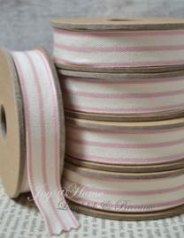 Kartonnen spoel met lint. Offwhite met een roze streepje