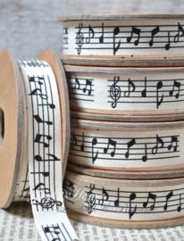 Kartonnen spoel met lint. Muzieknoten, offwhite/zwart