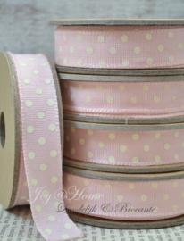 Kartonnen spoel met lint. Roze met crème stippen