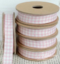 Kartonnen spoel met lint. Roze/wit geruit