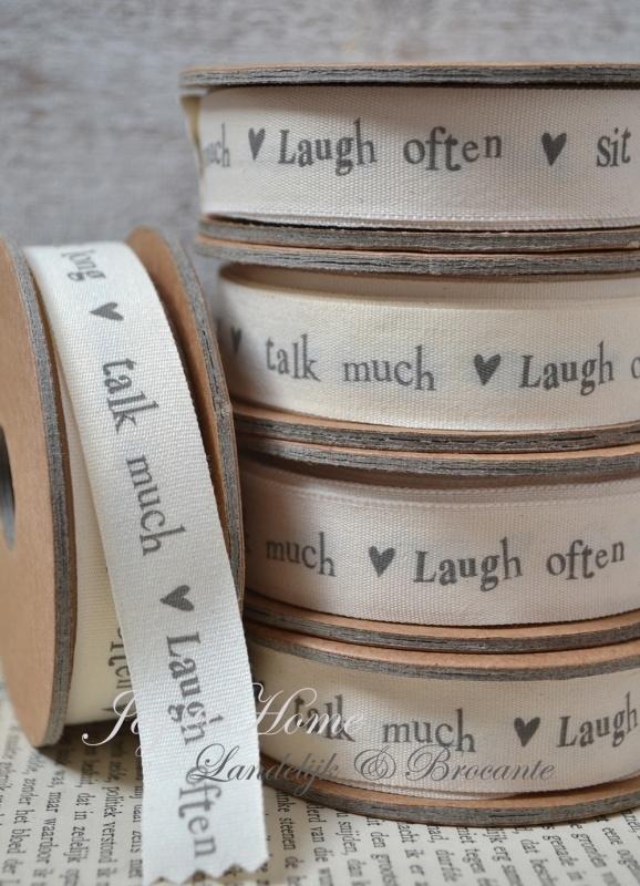 Kartonnen spoel met lint. Laugh often - sit long - talk much, offwhite/grijs
