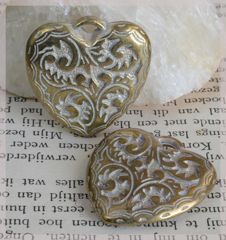 Bedeltje goud/zilverkleur, hart