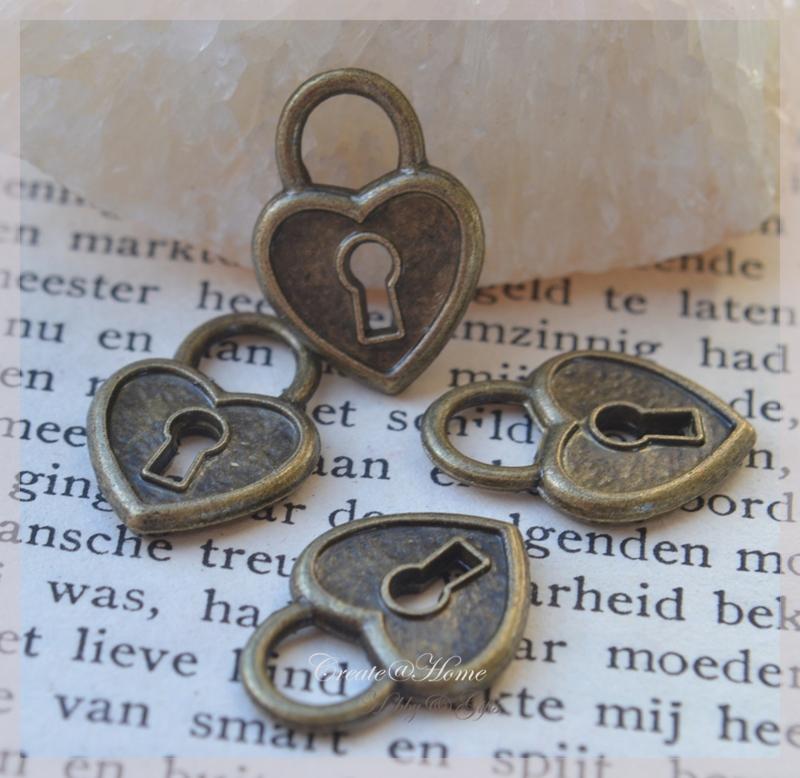 Bedeltje bronskleur, hartje/slotje