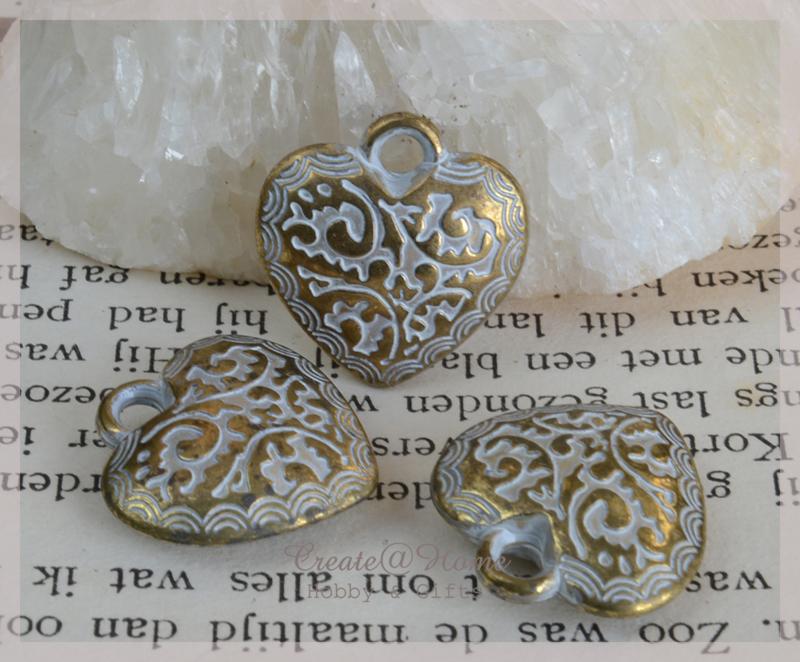 Bedeltjes goud/zilverkleur, hartje
