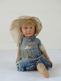 Antique doll with one leg