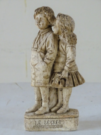 Statuette of boy and girl