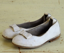 Antique leather children's shoes with bow