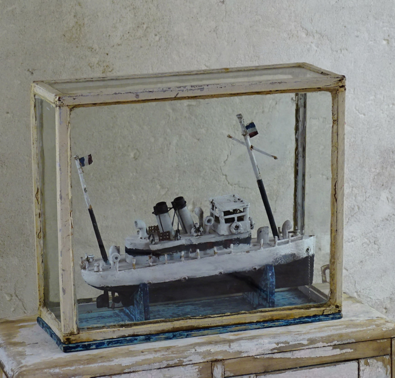 Ship in glass display case