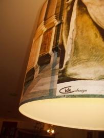 """""""Kunst-licht""""  is een  hanglamp bedrukt met 5 verschillende foto s."""