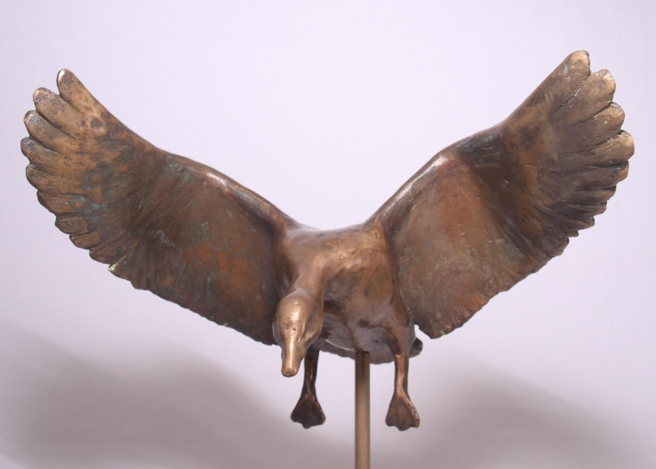 Gans bronzen beeld watervogel