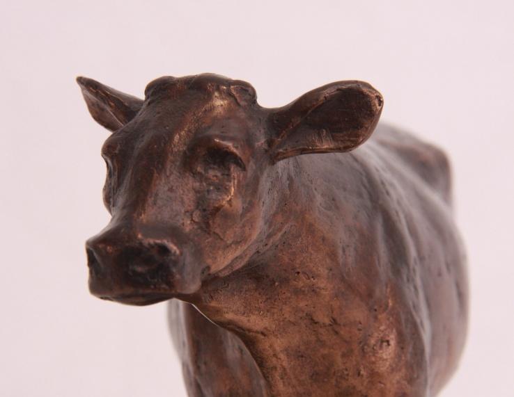 Koe dubbeldoelras - bronzen beeld