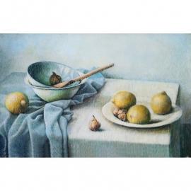 Stilleven met vier citroenen op tafel