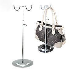 Verstelbare display voor het presenteren van tassen.