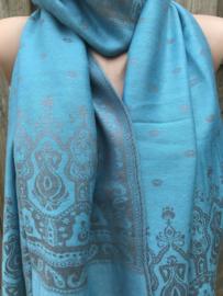 Turqouise sjaal met grijze print.