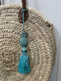 Turqouise hanger voor aan je tas.
