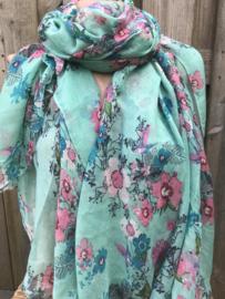 Mintkleurige sjaal met vrolijke bloemenprint.