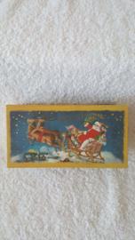 Arreslee met kerstman - doos met zeep en speeldoosje