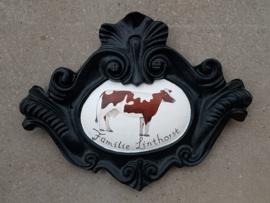Restauratie gietijzer naambord met koe