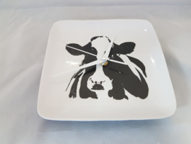 Clock cow of pottery