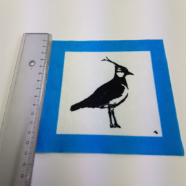 Vogel met blauwe rand: stofje