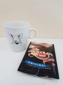 Verwenmoment: varken mok met chocolade melk