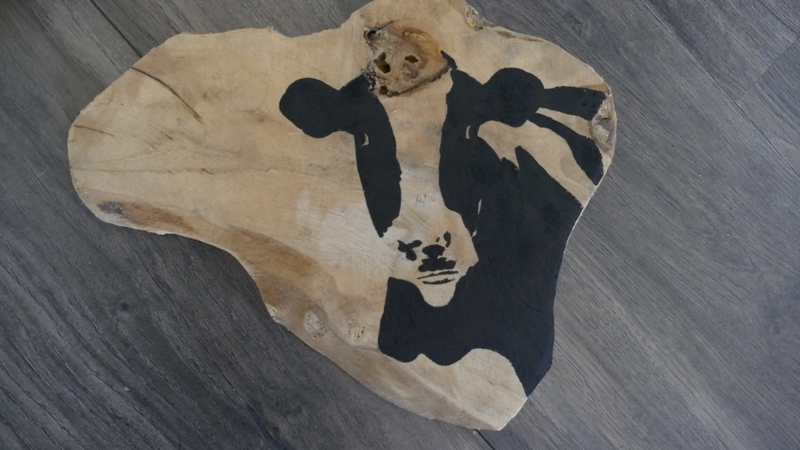 Teak wooden disk painted with cow.