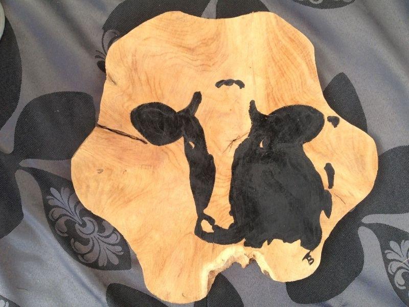 Houtenschijf beschilderd met koe