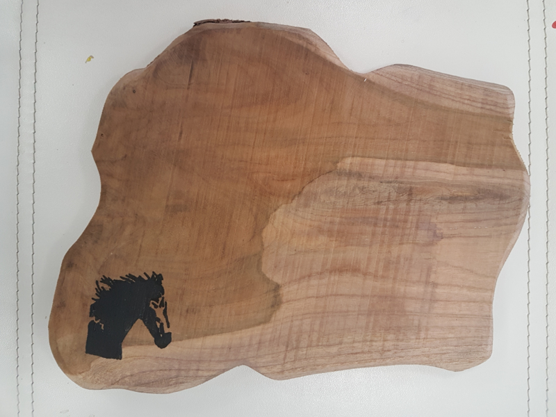 Teak plank with horse