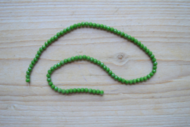 Kristalstreng groen gefacetteerde rondellen ca. 3 x 4 mm