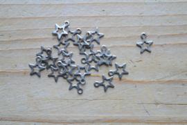 RVS bedel open ster ca. 7 x 10 mm per 5 stuks
